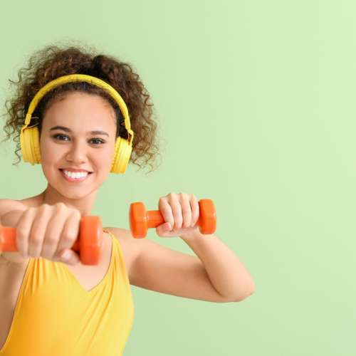 Young woman doing aerobics on color background